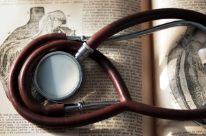 Old stethoscope on 19th century public domain medical dictionary
